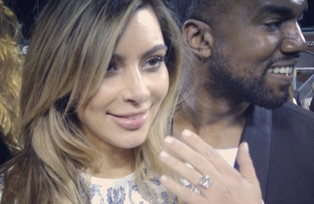 Kim Kardashian showing off engagement ring.