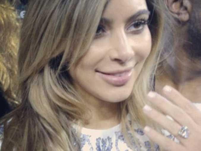 Kim Kardashian showing off engagement ring.