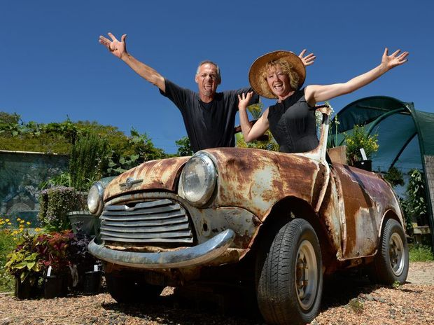 Greg James with wife Vanessa James and the 1967 Morris at Farmer's Choice Organics.