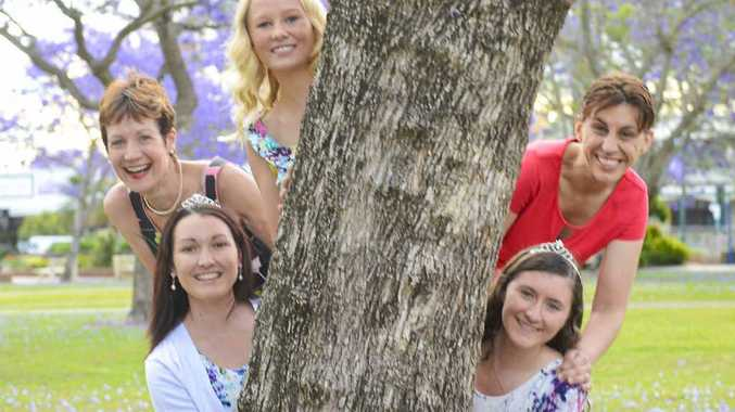 COUNTDOWN: The Jacaranda candidates have fun in the jacarandas at Market Square before the serious business of the crowning rehearsal. Matron Of Honour Jen Townsend (left), with Amy Freeman, Cerene Lowe, Chloe Hackett and Christie Paterson. PHOTO: ADAM HOURIGAN