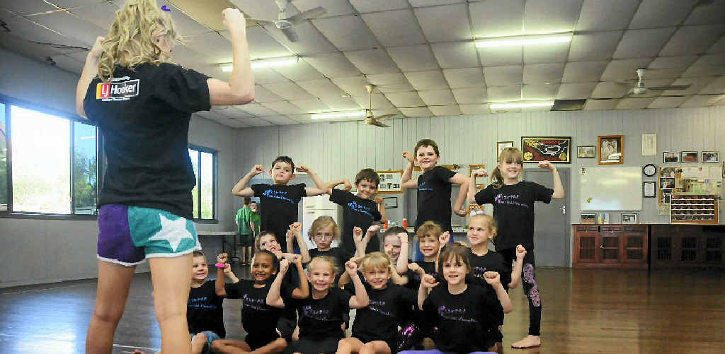 LOOKING GOOD: Years 3–7 in class at Miss Tamara's School of Dance and Fitness wear the new donated t-shirts.