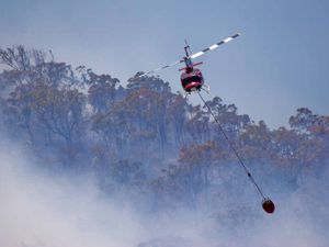 Emerald helicopters fly in to battle NSW blazes