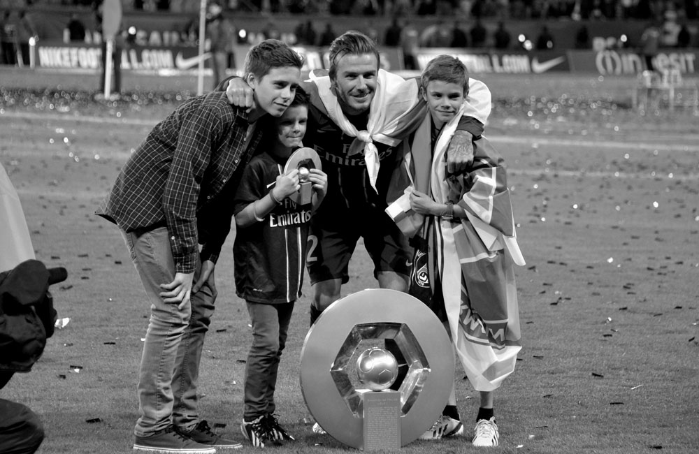 David Beckham with his sons after PSG's league win