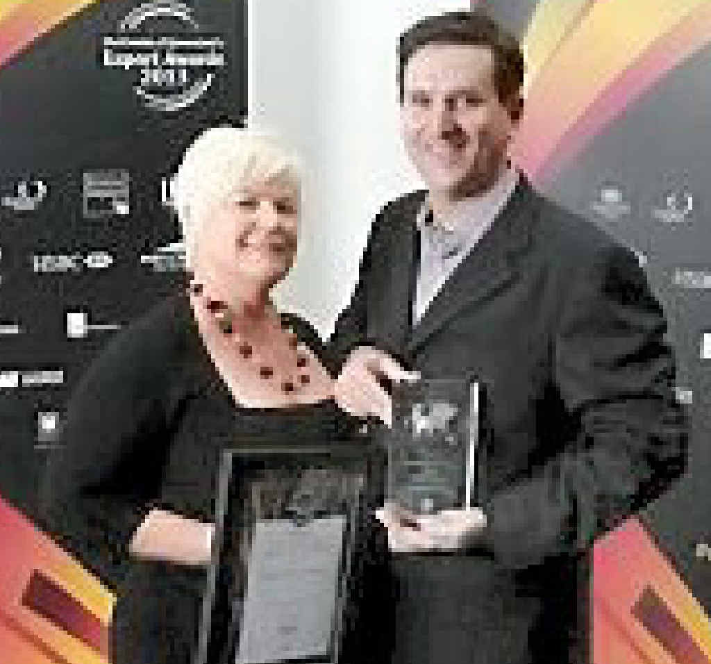 Bundaberg Brewed Drinks director Rae-Lee Flemming and CEO John McLean receive the Exporter of the Year Award.