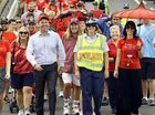 UNITED: Members of the Ipswich community walk up Limestone St to support Day for Daniel.