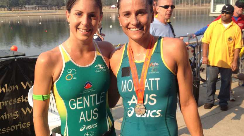 Emma Moffatt (right) and Ashleigh Gentle cool down after running in today's Nepean Triathlon.