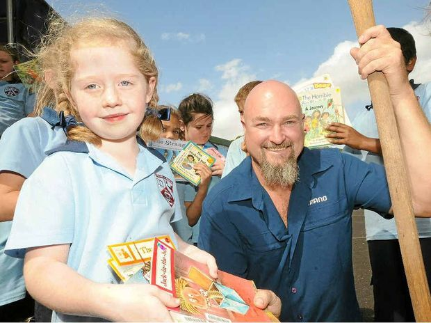 WRITE STUFF: Holly Whitelaw and her Goonellabah Public School classmates present Craig Hand with books for bush schools in Papua New Guinea's remote Western Province.