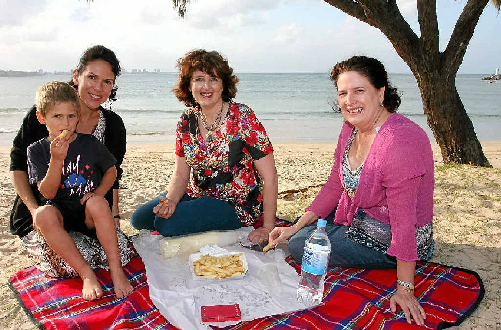 TRULY BLESSED: A perfect Sunday for Member for Maroochydore Fiona Simpson (centre) includes fish and chips at Mooloolaba Beach with friends Tanya McFadyen and son Dexter, 6, and Jessica Williams.