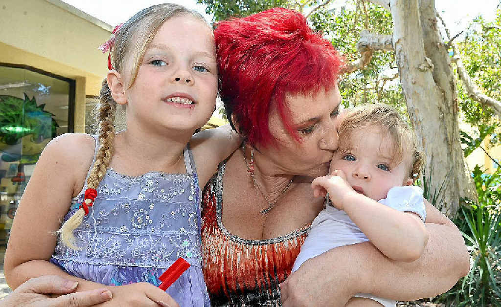 NANNA'S LOVE: Davina Allanson with grandchildren Lenaya, 6, and Myaha, 18 months, cuddle up at the launch of a Children in Grandparents Care group at Maroochydore Library.