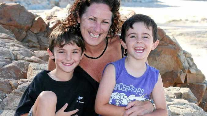 OUT AND ABOUT: Debbie Higgs shares time with her children, Bradley, 6, and Jacob, 4, at Coolum Beach.