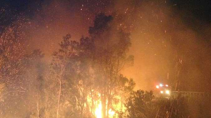 Acting Superintendent Col Neal shot this photo of fire blazing through bushland near Bilpin in New South Wales.