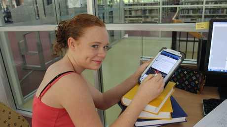 University of Southern Queensland student Sharelle Lindbeck 'hard at work' on Facebook.