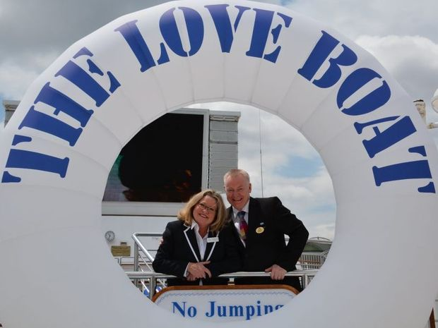 Love Boat actress Lauren Tewes, in her Julie McCoy cruise director uniform, celebrates her 60th birthday on the top deck of Sea Princess in Brisbane. Pictured with current cruise director Stuart McGuillan.