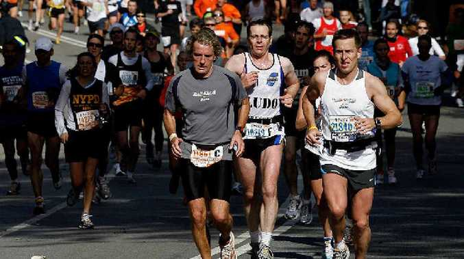 BAD LUCK: Michael Shadforth, below right, is out of the New York marathon after a fall from his bike.