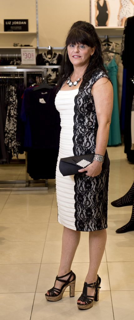 Nicci Richards in a lace and bandage dress.