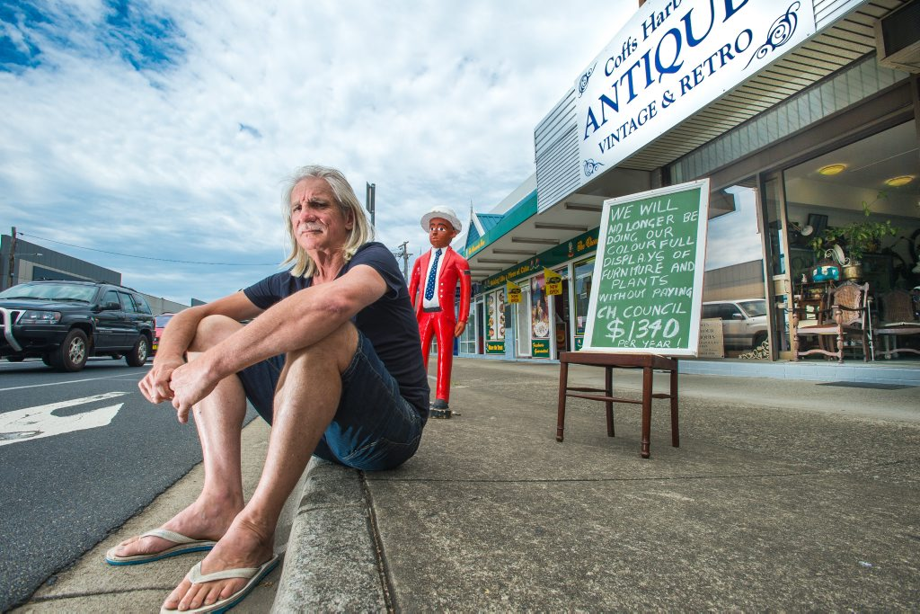 Coffs Harbour Antiques is no longer allowed to put its display on footpath. Baden Lang with the judge.