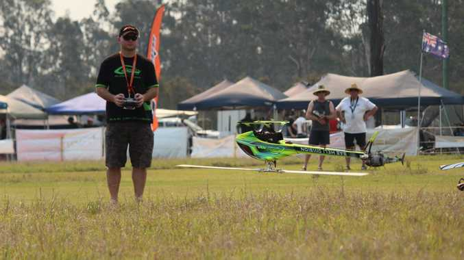 Jody Hodgson of Newcastle was having fun with his radio controlled helicopters at the inaugural Grafton Helifest at South Grafton over the weekend Photo Contributed NO RESALE