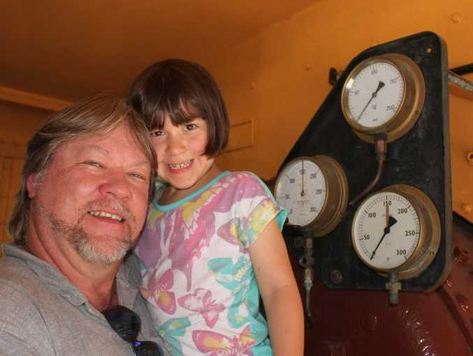 Jason Lambert and five-year-old daughter Jazmin enjoying the family fun day at the Archer Park Rail Museum. The Morning Bulletin / ROK271013parcher1