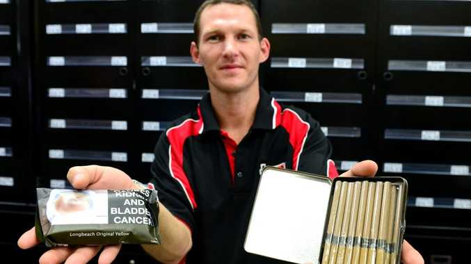 Alan Cranston with a tobacco pouch and mini cigar. Photo Sharyn O'Neill / The Morning Bulletin