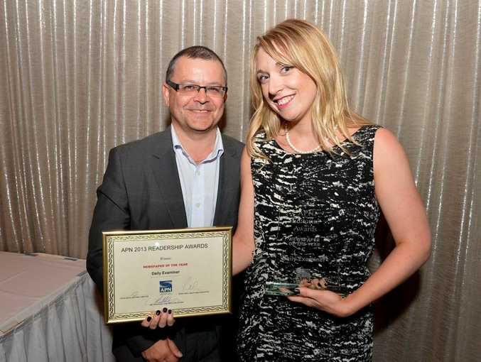 CEO for the Australian Regional Media division Neil Monaghan congratulates Daily Examiner editor Jenna Cairney on winning the Newspaper of the Year. Warren Lynam / Sunshine Coast Daily