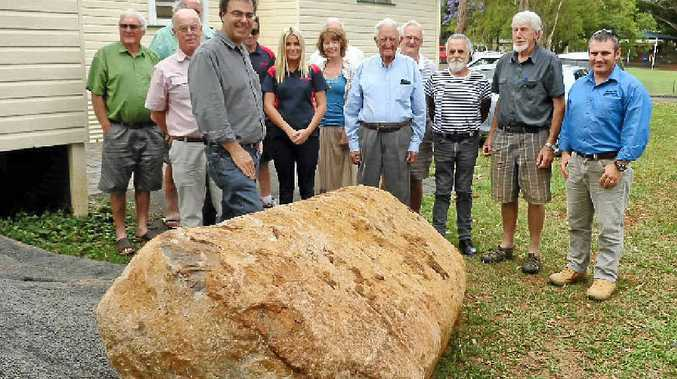 ROCK SOLID: Roads and Maritime Services senior project manager Peter Borrelli (front with glasses) with Bangalow RSL Hall committee members and community members.
