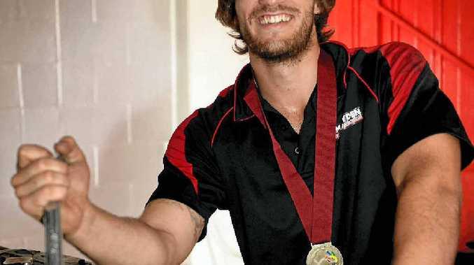 HANDY MAN: Clay Scott has won the award for being the region's best under-23 mechanic.