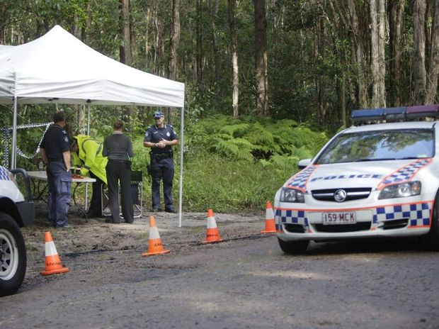 Police investigate a suspicious death after a body was located in a burnt out vehicle in bushland off Sippy Creek Road, Tanawha. A house on Horseshoe Bend at Buderim was also declared a crime scene.