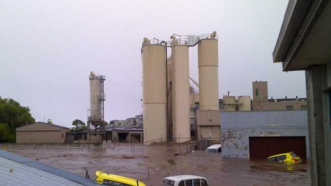 Cars swamped behind silos at Allied Mills during the 2011 floods.