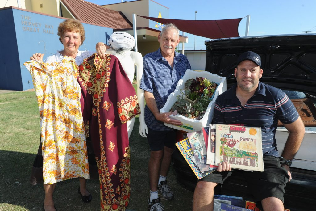 Getting ready for the annual swap meet at Hervey Bay High oval are Averil Collins with vintage clothes, Gary Dunne with plants and Roy Brown with records.