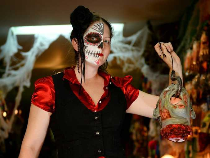 Manager of the Happy Herb Shop Amanda Charles getting into the halloween spirit. Photo Allan Reinikka / The Morning Bulletin