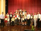 Mayor Gerard O'Connell (right) and MP Keith Pitt (left) with new Australian citizens after a ceremony at Maryborough City Hall.
