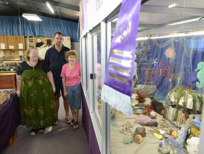 IT'S A GEM: Elizabeth Watkins, Simon Ashbrooke and Elaine Broadfoot of the Grafton Gem Club with their winning Jacaranda Window Display. Photo: Adam Hourigan