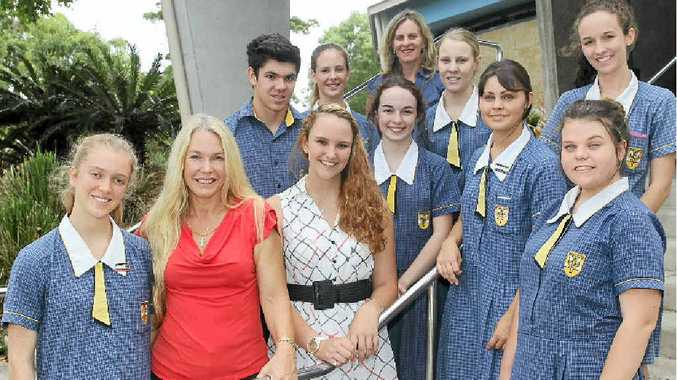 Karen Marsh of Centacare and Erin Gold with Immanuel Lutheran College students who raised money for the Juvenile Diabetes Research Foundation and two other charities.