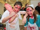 ZOMBIE WALK: Jaidyn and Kiah Norris prepare for the zombie invasion at Hinkler Central. Photo: Max Fleet / NewsMail