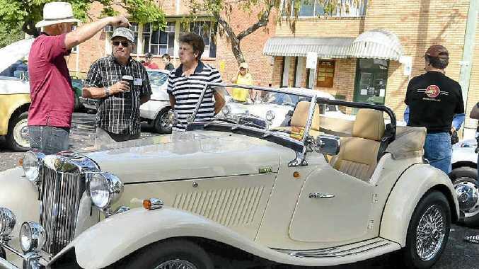 DRIVING PASSION: John Bowell, Tony Johnson and Bev Hannah at last year's Jacaranda Vintage Car Club display. Photo: Debrah Novak