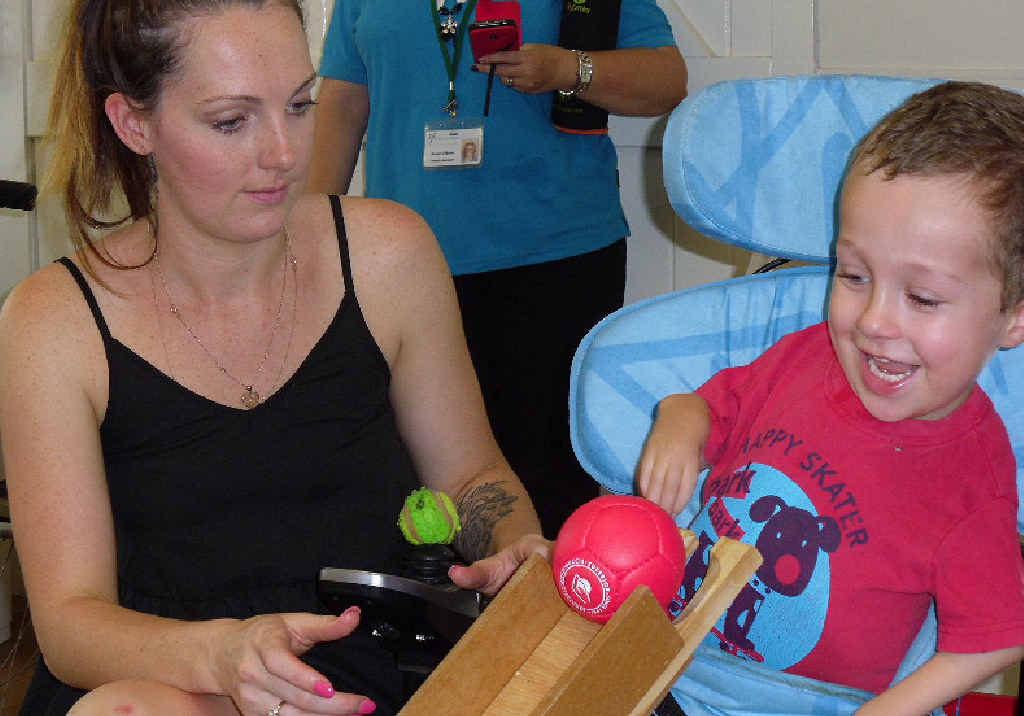 Celia Knight and her son William Brady play his first game of boccia.