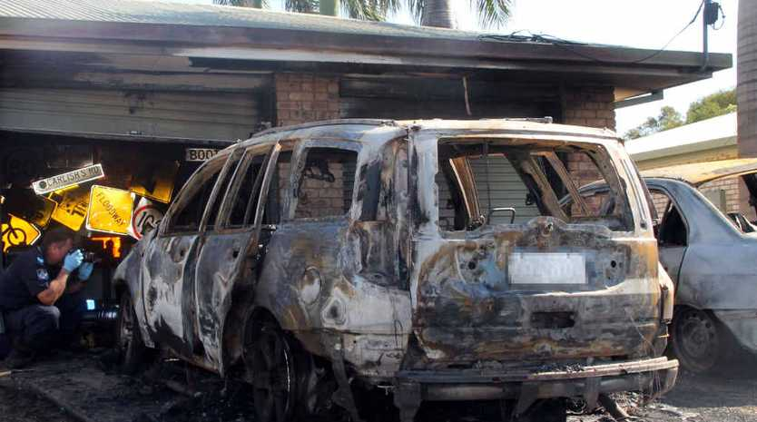BURNT OUT: The fire left one car gutted and the other severely damaged, but did not harm anyone.