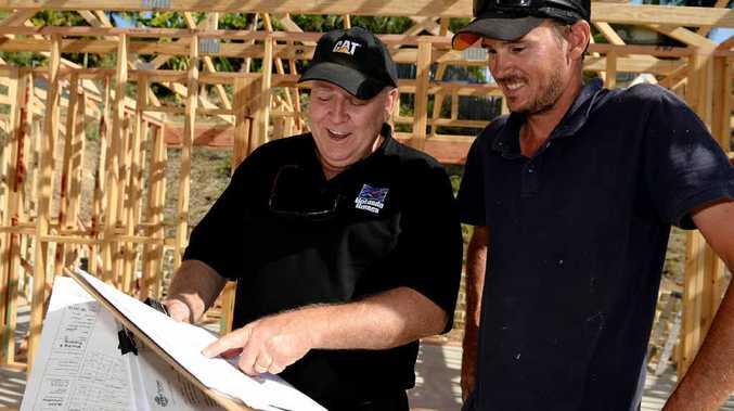 STEADY GROWTH: Hotondo Homes Rockhampton franchisee Brett Louttit discusses construction plans with carpenter Michael Docherty.