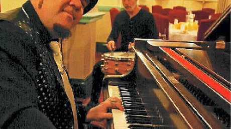 PUGSLEY BUZZARD: Piano player extraordinaire.