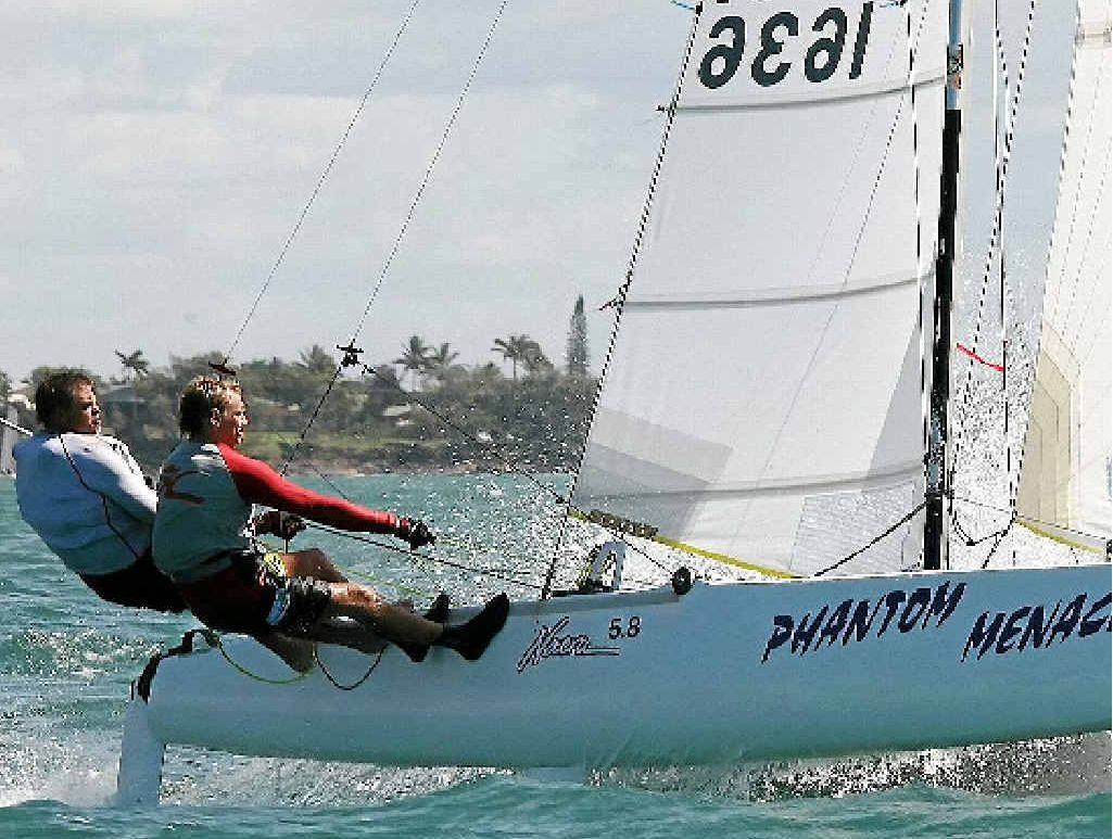 ABOVE: Brad Kroning and Josh Petersen aboard Phantom Menace in the first championship race of the Bundaberg Sailing Club's new season. INSET: Michael and Gale Bayer finished first in the All Boats class.