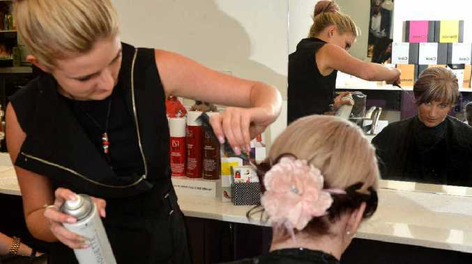 Hairstylist Kaylissa Neilsen, of Klippitz Hairworld, works on a Melbourne Cup hairstyle for Claire Andrew in preparation for the big day.