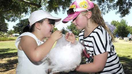 Enjoying fairy floss are Tegan Sander (left) and Riley McNally.