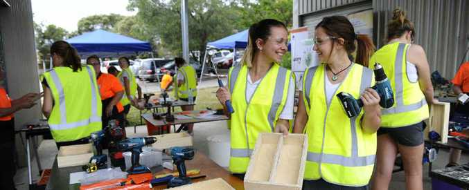 NEW SKILLS: South Grafton High School students Kira Grant and Karlie Chevalley learn how to use power tools during a SALT women in trade workshop held at the school on Wednesday. PHOTO: JOJO NEWBY