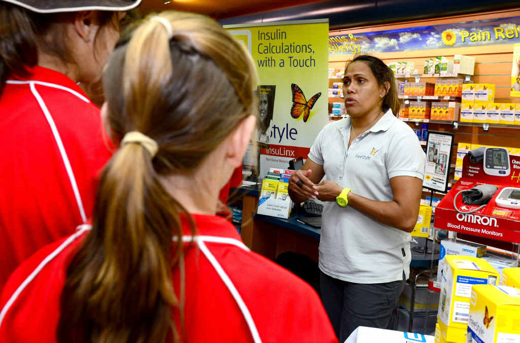 AFFLICTED CHAMP: Cathy Freeman tells some young fans about Diabetes at Auscare Pharmacy, City Centre Plaza, following the Diabetes Expo.