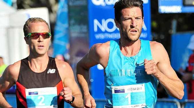 WINNING HABIT: Victoria's Collis Birmingham breaks clear in the Asics 5km Bolt at Noosa yesterday.