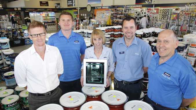 The Dulux Trade Centre at Maroochydore has taken out the national store of the year. Pictured are staff members (L-R) Mark McCallum, Steve Elmer, manager Christine Perkins, Geoff Playfair and Les Robbins.