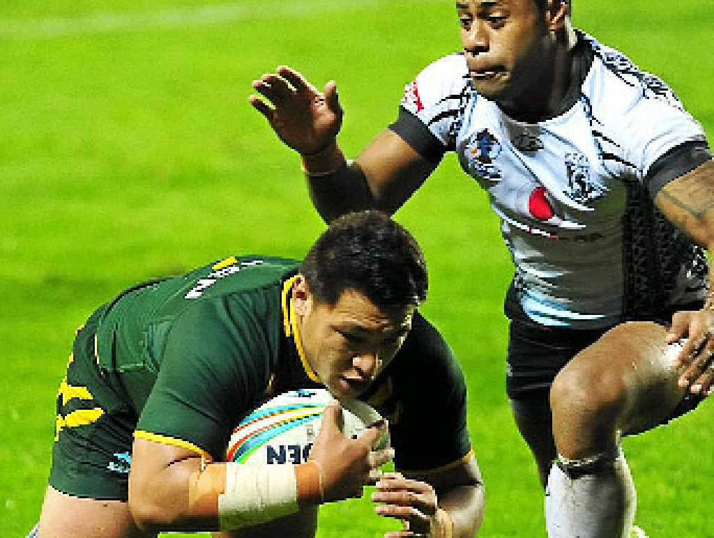 TRY TIME: Australian back-rower Josh Papalii dives over for a try in the World Cup win against Fiji at Langtree Park, St Helens.