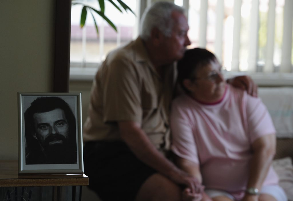 Tinana's Bill and Jan Cross with a photo of Robert who went missing in 2006. In September, Mr Cross said  he believed the bones found belonged to his son who was 36 when he went missing.