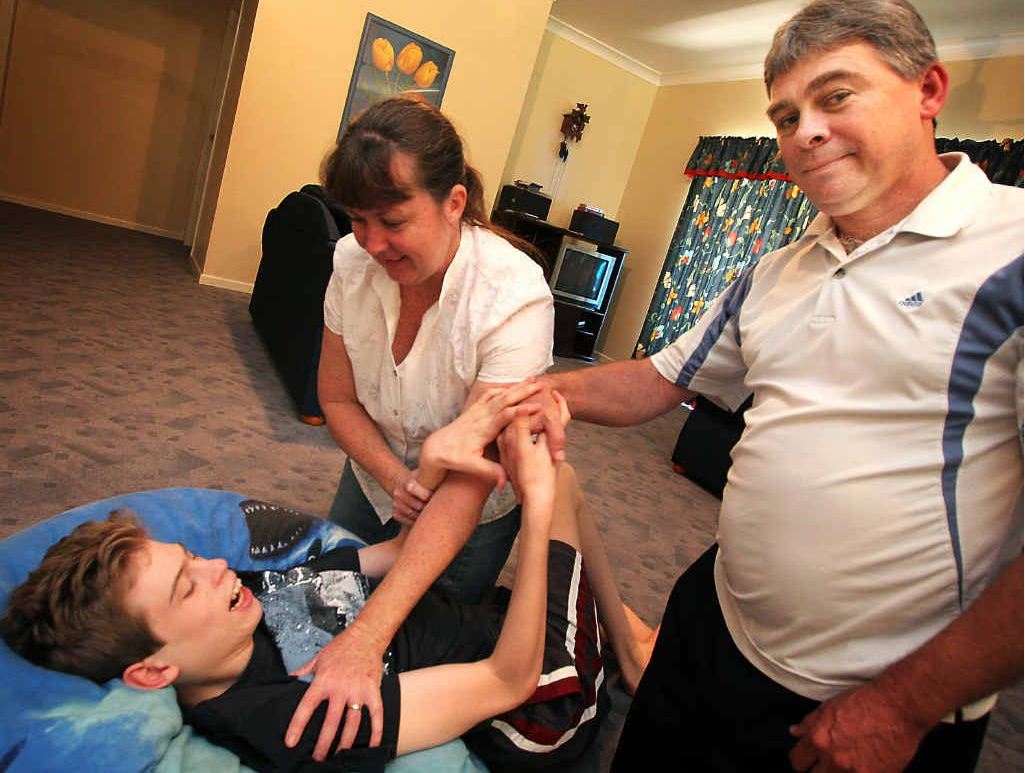 CARING PARENTS: Debra and Lance Alder look after their son Trent in their Rockhampton home.