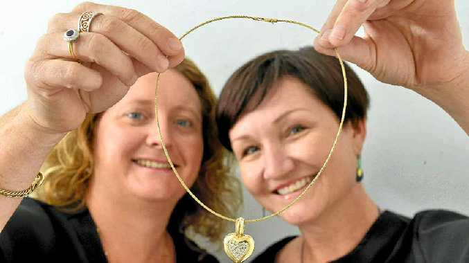 Lesleigh Joyner and Rita Williams, of Sunstate Jewellers, with the diamond pendant which will raise money for the Salvos.